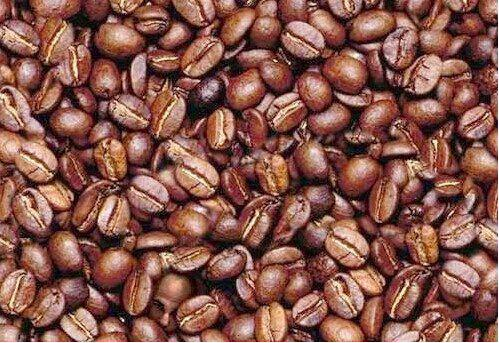 Find the human face in the coffee beans