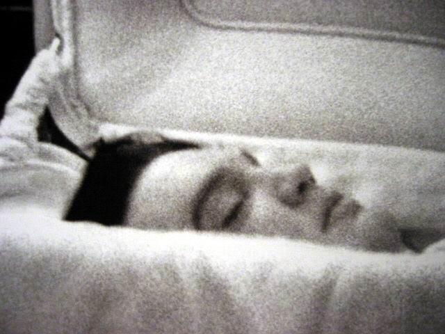 Closeup of Elvis Presley face in casket