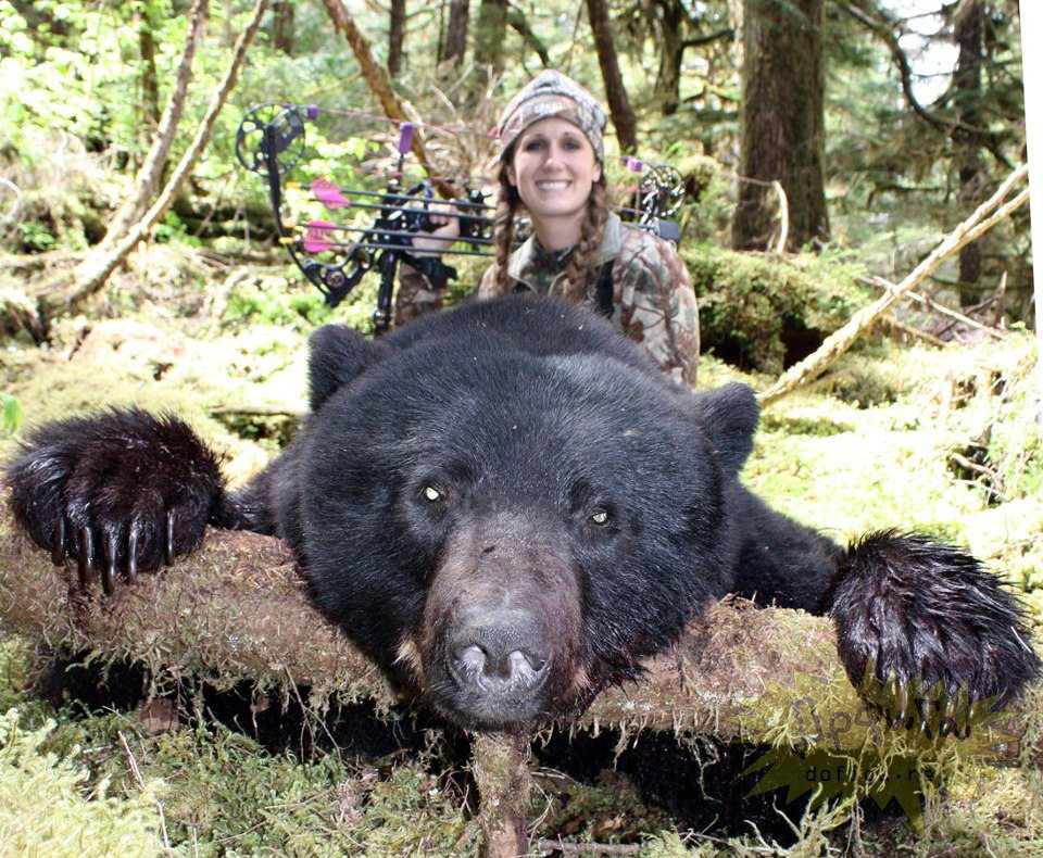 Melissa Bachman posing with dead bear