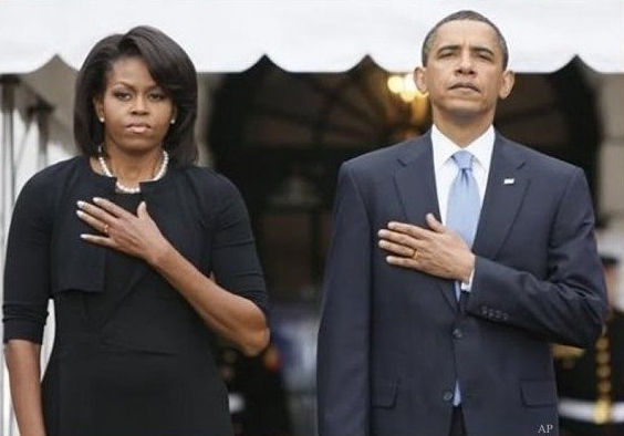 This is an altered photo to make it look as if the Obamas were saluting with the wrong hand.