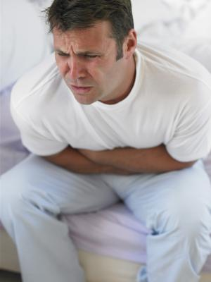 Distressed man holding stomach