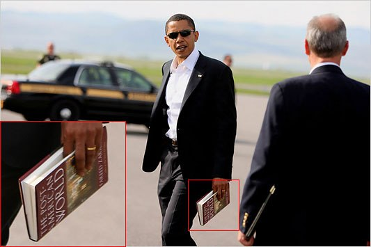 "President Obama holding ""The Post-American World"" book"