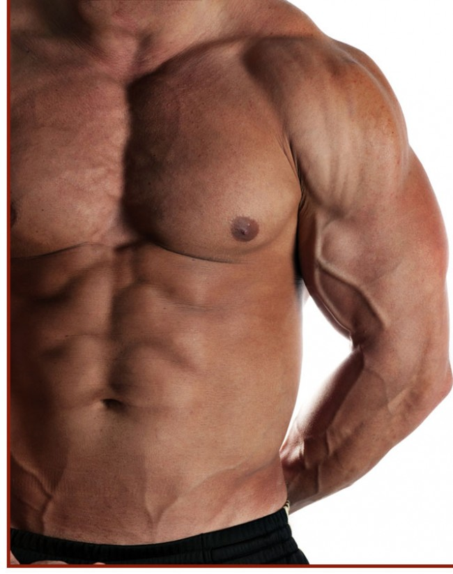 Muscular male flexing