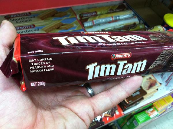 Package of Tim Tams in hand