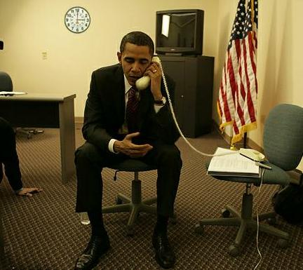 Fake photo of President Obama holding phone upside down