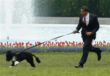 President Obama running with dog