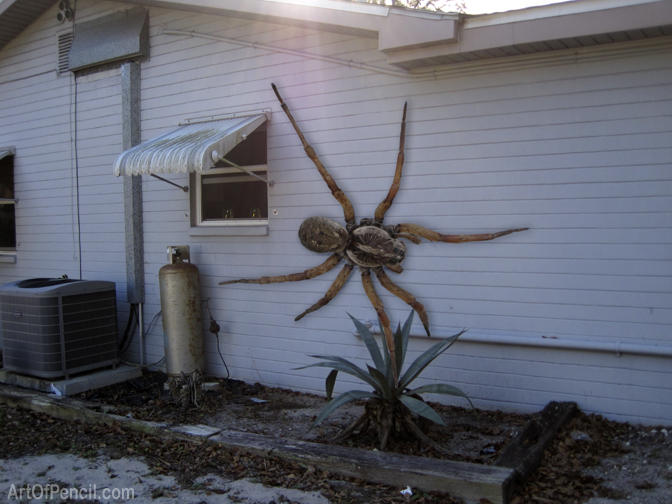 Fake photo of giant spider on side of house