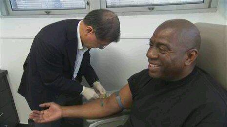 Magic Johnson having blood drawn