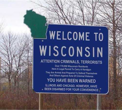 Fake Welcome to Wisconsin sign with gun warning