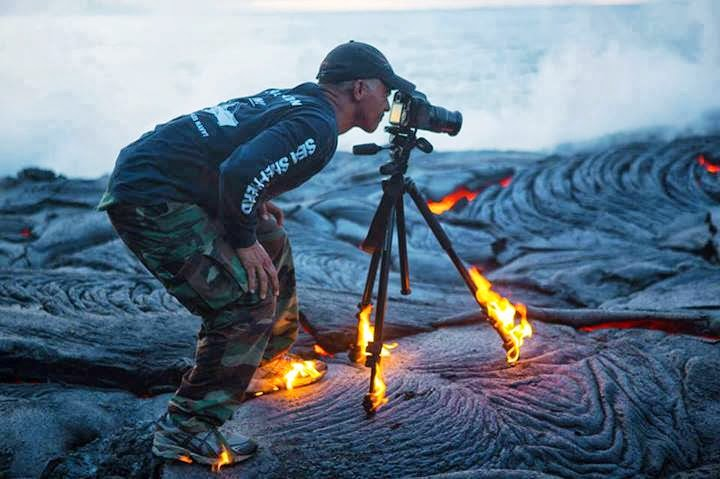 Man photographing volcano