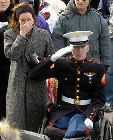 Amputee soldier in wheelchair salutes