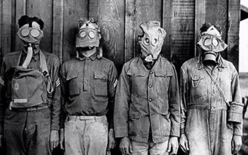 Old photo of men wearing gas masks