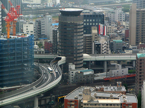 Skyscraper with highway tunnel through it